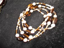 4 X LADIES PRETTY ELASTICASTED MULTI BEAD BRACELETS AMBER AND PINK TONES